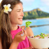 Salad eating healthy woman at restaurant in Hawaii